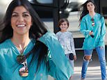 14.June.2016 - Thousand Oaks - USA\n*** STRICTLY AVAILABLE FOR UK AND GERMANY USE ONLY ***\n** EXCLUSIVE ALL ROUND PICTURES **\nThousand Oaks, CA - Kourtney Kardashian and Mason leave an office building together with big smiles on their faces. Mason goofs around with his reality star mom hiding behind her as they walk. Kourtney is wearing ripped jeans and a long sleeve turquoise Pablo tee paired with heels. \nBYLINE MUST READ : AKM-GSI-XPOSURE\n***UK CLIENTS - PICTURES CONTAINING CHILDREN PLEASE PIXELATE FACE PRIOR TO PUBLICATION ***\n*UK CLIENTS MUST CALL PRIOR TO TV OR ONLINE USAGE PLEASE TELEPHONE 0208 344 2007*\n