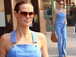 Heidi Klum spotted out and about in New York City wearing fitted denim overalls.\n\nPictured: Heidi Klum\nRef: SPL1302353  150616  \nPicture by: Splash News\n\nSplash News and Pictures\nLos Angeles: 310-821-2666\nNew York: 212-619-2666\nLondon: 870-934-2666\nphotodesk@splashnews.com\n