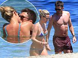 13 June 2016 - Ibiza - Spain *EXCLUSIVE ALL ROUND PICTURES* *STRICTLY NOT AVAILABLE FOR ITALY, FRANCE AND SPAIN* England and Manchester United Footballer Michael Carrick who had recently signed a new one year contract at Old Trafford is relaxing during the Premier League break on holiday on the beaches of Ibiza with his wife Lisa Carrick. The Couple are seen showing their affection as they cuddle up together in the sea.  BYLINE MUST READ : XPOSUREPHOTOS.COM ***UK CLIENTS - PICTURES CONTAINING CHILDREN PLEASE PIXELATE FACE PRIOR TO PUBLICATION *** **UK CLIENTS MUST CALL PRIOR TO TV OR ONLINE USAGE PLEASE TELEPHONE 44 208 344 2007**