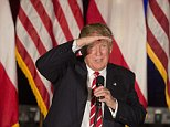 Republican presidential candidate Donald Trump shields his eyes as he speaks during a rally at the Fox Theater, Wednesday, June 15, 2016, in Atlanta. (AP Photo/John Bazemore)