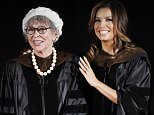 Honoree Rita Moreno, left, is joined on stage by speaker Eva Longoria during the 2016 AFI Conservatory Commencement at the TCL Chinese Theatre on Wednesday, June 15, 2016, in Los Angeles. (Photo by Chris Pizzello/Invision/AP)