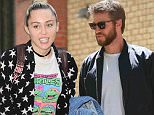 Miley Cyrus spotted hiding from paparazzi while out and about in New York City, as entering into a residential building in the upper east side \n\nPictured: Miley Cyrus\nRef: SPL1302849  150616  \nPicture by: Felipe Ramales / Splash News\n\nSplash News and Pictures\nLos Angeles: 310-821-2666\nNew York: 212-619-2666\nLondon: 870-934-2666\nphotodesk@splashnews.com\n