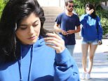 Please contact X17 before any use of these exclusive photos - x17@x17agency.com   Tuesday, June 14, 2016 - Kylie Jenner hides behind Scott Disick as they get sushi together at SUGARFISH wearing matching shades of blue in Calabasas, CA. Kylie supports brother-in-law Kanye West wearing a blue Life of Pablo hoodie paired with extremely short cutoffs and Scott wears a blue t-shirt and blue jeans. AZ-Daddy/X17online.com PREMIUM EXCLUSIVE