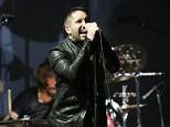 Trent Reznor performs on stage at the 56th annual GRAMMY Awards at Staples Center on Jan. 26, 2014, in Los Angeles, United States.     (Photo by Matt Sayles/Invision/AP)
