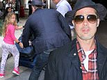 Los Angeles, CA - Brad Pitt and his bodyguards make their way through LAX as they head out of Town, Pitt was nice enough to stop and pick up a little girl's toy as they passed by each other. He looked cool as usual, sporting a Fedora hat that completed his business casual look. \nAKM-GSI      June 15, 2016\nTo License These Photos, Please Contact :\nMaria Buda\n(917) 242-1505\nmbuda@akmgsi.com\nsales@akmgsi.com\nor\nMark Satter\n(317) 691-9592\nmsatter@akmgsi.com\nsales@akmgsi.com\nwww.akmgsi.com