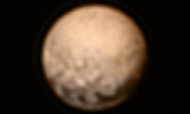 Nasa reveals new image of Pluto's four 'alien black spots'
