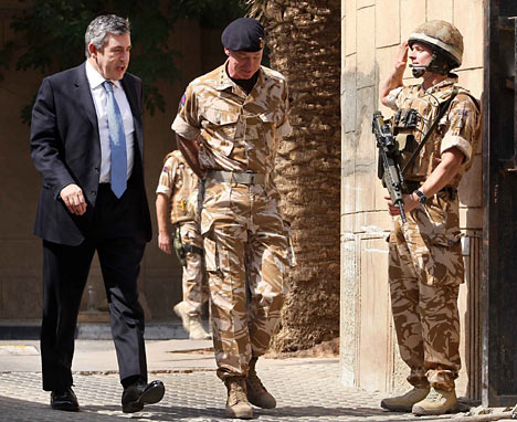 Prime Minister Gordon Brown (L) walks with Air Chief Marshall Sir Jock Stirrup, Chief of the Defence Staff