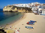 View of the beach at picturesque fishing village of Carvoeiro on the Algarve coast, Portugal