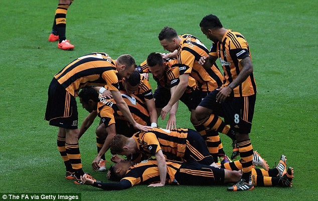 Double: Hull City players mob Curtis Davies after he scored their second goal, but they couldn't hold on