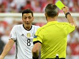 epa05370699 Mesut Oezil (C) of Germany is booked during the UEFA EURO 2016 group C preliminary round match between Germany and Poland at Stade de France in Saint-Denis, France, 16 June 2016. (RESTRICTIONS APPLY: For editorial news reporting purposes only. Not used for commercial or marketing purposes without prior written approval of UEFA. Images must appear as still images and must not emulate match action video footage. Photographs published in online publications (whether via the Internet or otherwise) shall have an interval of at least 20 seconds between the posting.)  EPA/FILIP SINGER   EDITORIAL USE ONLY