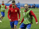 epa05370711 Spanish players Andres Iniesta (R) and Lucas Vazquez during a training session of the Spanish team at Stade de Nice in Nice, France, 16 June 2016. Spain will face Turkey in the UEFA EURO 2016 Group D soccer match on 17 June 2016.  (RESTRICTIONS APPLY: For editorial news reporting purposes only. Not used for commercial or marketing purposes without prior written approval of UEFA. Images must appear as still images and must not emulate match action video footage. Photographs published in online publications (whether via the Internet or otherwise) shall have an interval of at least 20 seconds between the posting.)  EPA/SEBASTIEN NOGIER   EDITORIAL USE ONLY