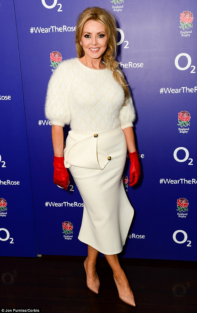 Patriotic: Carol Vorderman dressed in white and red to see the England Rugby team off in style at the Wear The Rose Live party at London's O2 on Wednesday night