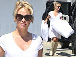 *EXCLUSIVE* Malibu, CA - Pamela Anderson packs her ride with pillows at her storage unit in Malibu. The actress wore a nearly transparent white dress with knee-high beige boots and sunglasses as she loaded multiple large fluffy pillows into her car before returning back to her house.\nAKM-GSI   June  16, 2016\nTo License These Photos, Please Contact :\nMaria Buda\n(917) 242-1505\nmbuda@akmgsi.com\nsales@akmgsi.com\nor \nMark Satter\n(317) 691-9592\nmsatter@akmgsi.com\nsales@akmgsi.com\nwww.akmgsi.com