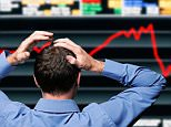 Stock Trader Clutching His Head in Front of a Screen Showing a Stock Market Crash.  BCW2K1
