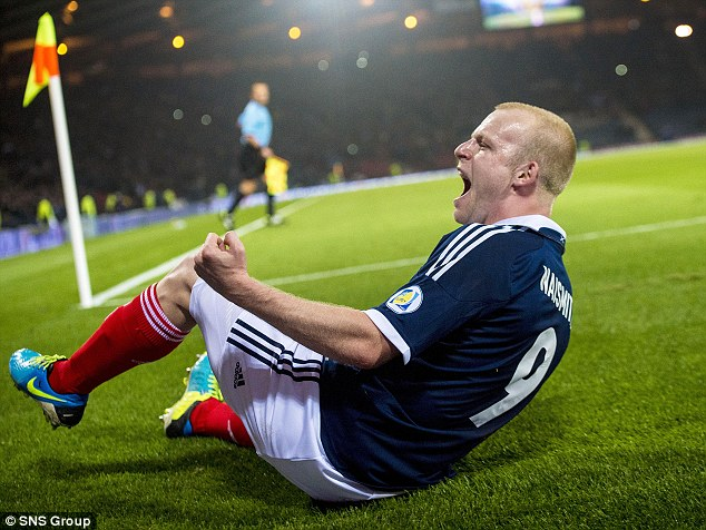 Get in: Naismith roars with delight after scoring Scotland's second goal