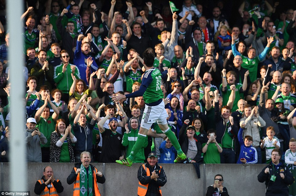 The Northern Ireland supporters salute the striker after he gave the hosts the lead inside seven minutes at Windsor Park on Friday night