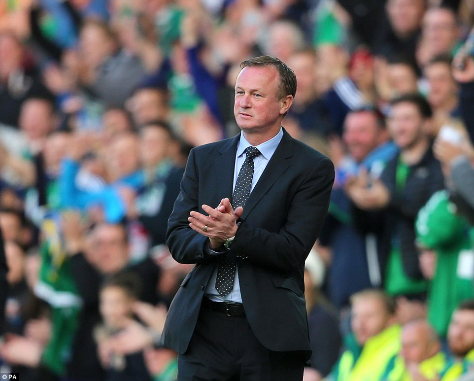 Michael O'Neill applauds his side after the opening goal and the Northern Ireland manager will have been encouraged by the display