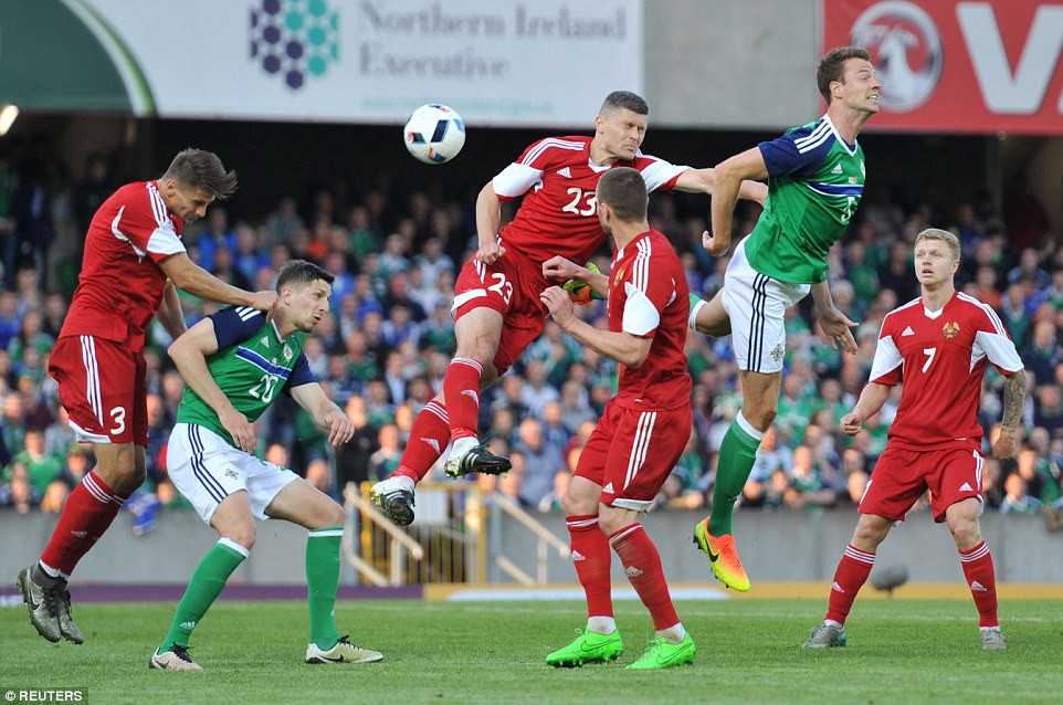 Northern Ireland defender Jonny Evans heads at goal during the first half at Windsor Park as the hosts made a fine start to proceedings