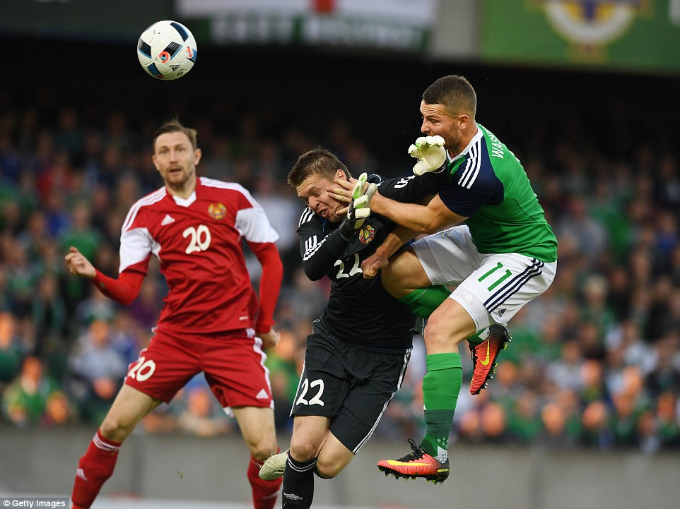 Washington showed good bravery to get in front of the Belarus stopper to double the lead for Northern Ireland on the stroke of half time