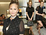 COSTA MESA, CA - JUNE 16: Chrissy Teigen poses with a Disney Coach purse at COACH's Pre-Fall 2016 Collection at the Coach South Coast Plaza boutique on June 16, 2016 in Costa Mesa, California. (Photo by Ryan Miller/Getty Images for COACH)