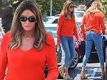Exclusive. Coleman-Rayner Malibu, CA. USA. June 16th 2016 Caitlyn Jenner struggles to get comfortably inside her purple Porsche GT3RS sports car. The Olympic gold medalist wore a bright orange top with tight jeans and heels while out shopping at a Malibu mall today.  CREDIT LINE MUST READ: RF/Coleman-Rayner Tel US (001) 310 474 4343 - office  Tel US (001) 323 545 7584 - cell www.coleman-rayner.com