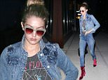 """Picture Shows: Gigi Hadid  June 16, 2016\n \n Model Gigi Hadid out and about in New York City, New York.  She wore a jean jacket with matching jeans and bright red boots. Gigi and one of her best friends Kylie Jenner were criticized by a model, who stated that they were not considered """"supermodels"""". The two took the higher road and did not retaliate.\n \n Non Exclusive\n UK RIGHTS ONLY\n \n Pictures by : FameFlynet UK � 2016\n Tel : +44 (0)20 3551 5049\n Email : info@fameflynet.uk.com"""