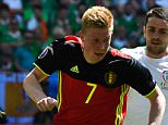 Ireland's midfielder James McCarthy (R) challenges Belgium's midfielder Kevin De Bruyne  during the Euro 2016 group E football match between Belgium and Ireland at the Matmut Atlantique stadium in Bordeaux on June 18, 2016. / AFP PHOTO / GEORGES GOBETGEORGES GOBET/AFP/Getty Images