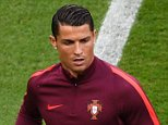 Portugal's forward Cristiano Ronaldo warms up ahead the Euro 2016 group F football match between Portugal and Austria at the Parc des Princes in Paris on June 18, 2016. / AFP PHOTO / MIGUEL MEDINAMIGUEL MEDINA/AFP/Getty Images
