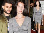 West Hollywood, CA - Bella Hadid and boyfriend, The Weeknd are spotted leaving a dinner date at famous Italian eatery, Madeo Restaurant. Bella looks sexy in a low plunging gray wrap dress while her boyfriend keeps it casual in a Supreme tee, jeans, and olive bomber.\nAKM-GSI       June 17, 2016\nTo License These Photos, Please Contact :\nMaria Buda\n(917) 242-1505\nmbuda@akmgsi.com\nsales@akmgsi.com\nor \nMark Satter\n(317) 691-9592\nmsatter@akmgsi.com\nsales@akmgsi.com\nwww.akmgsi.com