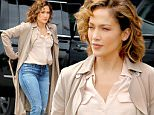 Actress Jennifer Lopez, wearing a trench coat, jeans and Converse sneakers, films 'Shades of Blue' at the Water Ferry Dock in New York City on June 17, 2016\n\nPictured: Jennifer Lopez\nRef: SPL1303941  170616  \nPicture by: Christopher Peterson/Splash News\n\nSplash News and Pictures\nLos Angeles: 310-821-2666\nNew York: 212-619-2666\nLondon: 870-934-2666\nphotodesk@splashnews.com\n