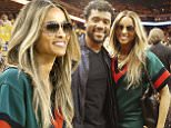 Seattle Seahawks quarterback Russell Wilson, left, and Ciara watch as players warm up before Game 7 of basketball's NBA Finals between the Golden State Warriors and the Cleveland Cavaliers in Oakland, Calif., Sunday, June 19, 2016. (AP Photo/Marcio Jose Sanchez)