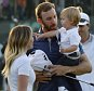 Jun 19, 2016; Oakmont, PA, USA; Dustin Johnson celebrates with fiance Paulina Gretzky while holding son Tatum after winning the U.S. Open golf tournament at Oakmont Country Club. Mandatory Credit: Michael Madrid-USA TODAY Sports