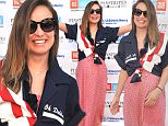 """OVERLAND PARK, KS - JUNE 18:  Olivia Wilde attends the Big Slick """"Red, White & Bowl"""" at Pinstripes during the 2016 Big Slick Celebrity Weekend on June 18, 2016 in Overland Park, Kansas.  (Photo by Fernando Leon/Getty Images)"""