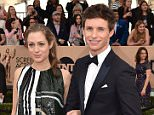 Hannah Bagshawe, left, and Eddie Redmayne arrive at the 22nd annual Screen Actors Guild Awards at the Shrine Auditorium & Expo Hall on Saturday, Jan. 30, 2016, in Los Angeles. (Photo by Jordan Strauss/Invision/AP)
