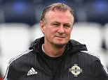 PARIS, FRANCE - JUNE 20:  Michael O'Neill, head coach of Northern Ireland looks on during a team Northern Ireland training session ahead of the UEFA EURO 2016 Group C match between Northern Ireland and Germany at Stade Parc de Princes  on June 20, 2016 in Paris, France.  (Photo by Alexander Hassenstein/Getty Images,)