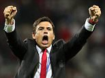 Wales coach Chris Coleman celebrates after the Euro 2016 Group B soccer match between Russia and Wales at the Stadium municipal in Toulouse, France, Monday, June 20, 2016. (AP Photo/Thanassis Stavrakis)