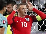 England's Wayne Rooney, center, reacts after a missed chance to score during the Euro 2016 Group B soccer match between Slovakia and England at the Geoffroy Guichard stadium in Saint-Etienne, France, Monday, June 20, 2016. (AP Photo/Francois Mori)