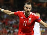 Wales' Gareth Bale celebrates scoring his side's third goal of the game during the UEFA Euro 2016, Group B match at Stadium Municipal, Toulouse. PRESS ASSOCIATION Photo. Picture date: Monday June 20, 2016. See PA story SOCCER Wales. Photo credit should read: Martin Rickett/PA Wire. RESTRICTIONS: Use subject to restrictions. Editorial use only. Book and magazine sales permitted providing not solely devoted to any one team/player/match. No commercial use. Call +44 (0)1158 447447 for further information.