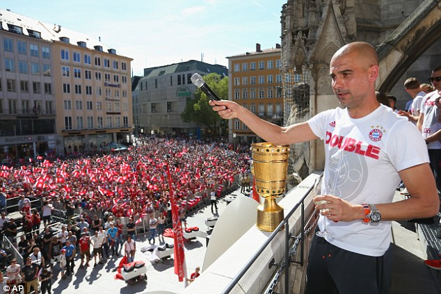 Bayern showed off the cup in Munich with the manager delighted to have given fans a shiny leaving present