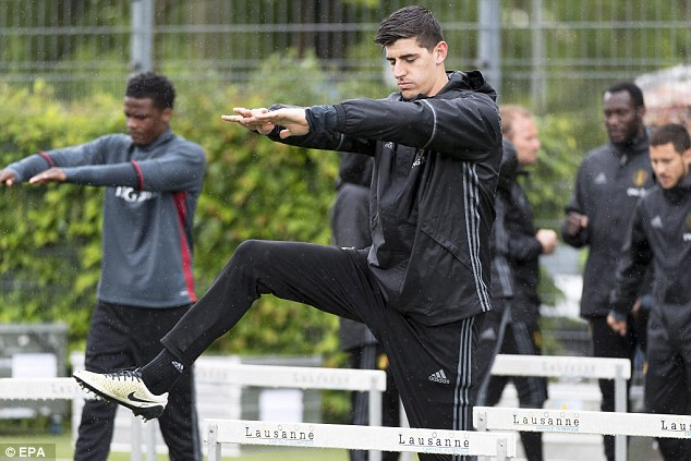 Belgium's No 1Thibaut Courtois dwarfs the hurdle as he stretches his legs in Lausanne, Switzerland