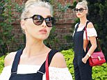 Elsa Hosk matches her red lipstick with her hand bag\n\nPictured: Elsa Hosk\nRef: SPL1305607  210616  \nPicture by: Splash News\n\nSplash News and Pictures\nLos Angeles: 310-821-2666\nNew York: 212-619-2666\nLondon: 870-934-2666\nphotodesk@splashnews.com\n