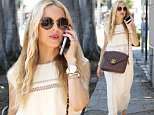 20.June.2016 - Beverly Hills ñ USA\n*** STRICTLY AVAILABLE FOR UK AND GERMANY USE ONLY ***\nBeverly Hills, CA - Rachel Zoe talks business before heading to lunch at Le Pain Quotidien in a beautiful white dress, brown leather Chanel crossover bag, and matching wedges.\nBYLINE MUST READ : AKM-GSI-XPOSURE\n***UK CLIENTS - PICTURES CONTAINING CHILDREN PLEASE PIXELATE FACE PRIOR TO PUBLICATION ***\n*UK CLIENTS MUST CALL PRIOR TO TV OR ONLINE USAGE PLEASE TELEPHONE 0208 344 2007*\n