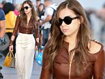 """Actress and Singer, Hailee Steinfeld wears a Sexy Brown Leather Jacket along with White Pants while catching a departing flight at Pearson International Airport in Toronto, Canada. Hailee Steinfeld was in Toronto performing her song """"Rock Bottom"""" at the 2016 iHeartRadio MMVAs (Much Music Video Awards) the night before.\n\nPictured: Hailee Steinfeld\nRef: SPL1305226  200616  \nPicture by: S Fernandez / Splash News\n\nSplash News and Pictures\nLos Angeles: 310-821-2666\nNew York: 212-619-2666\nLondon: 870-934-2666\nphotodesk@splashnews.com\n"""