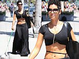 20.June.2016 - Beverly Hills ñ USA\n*** STRICTLY AVAILABLE FOR UK AND GERMANY USE ONLY ***\nBeverly Hills, CA - Nicole Murphy shows off her toned tummy after visiting the nail salon. It seems Nicole likes to take her curious pooch everywhere as the little dog is seen being nosy while sitting in Nicole's lap while she gets her nails done.\nBYLINE MUST READ : AKM-GSI-XPOSURE\n***UK CLIENTS - PICTURES CONTAINING CHILDREN PLEASE PIXELATE FACE PRIOR TO PUBLICATION ***\n*UK CLIENTS MUST CALL PRIOR TO TV OR ONLINE USAGE PLEASE TELEPHONE 0208 344 2007*\n