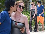 *PREMIUM EXCLUSIVE* Port Louis, Mauritius - Lindsay Lohan has the look of love as she smiles in total bliss during a romantic stroll with fiancee Egor Tarabasov.  Egor gave Lindsay a big kiss on the cheek while the two enjoyed the beach scenery.  Lindsay donned a silver one-piece bathing suit with mesh flares for the relaxing day on the beach. *Shot on May 14, 2016*  AKM-GSI     June 20, 2016 To License These Photos, Please Contact : Maria Buda (917) 242-1505 mbuda@akmgsi.com sales@akmgsi.com or  Mark Satter  (317) 691-9592  msatter@akmgsi.com  sales@akmgsi.com  www.akmgsi.com