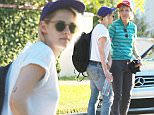 *EXCLUSIVE* Studio City, CA - Kristen Stewart and her girlfriend Alicia Cargile celebrate Father's Day with Kristen's dad in Studio City. The 'Twilght' actress dressed comfortably in a white t-shirt, ripped jeans, sunglasses and a backwards cap. Alicia wore a 'Make America Gay' hat that parodied Donald Trump's campaign hat.\nAKM-GSI      June 19, 2016\nTo License These Photos, Please Contact :\nMaria Buda\n(917) 242-1505\nmbuda@akmgsi.com\nsales@akmgsi.com\nor\nMark Satter\n(317) 691-9592\nmsatter@akmgsi.com\nsales@akmgsi.com\nwww.akmgsi.com