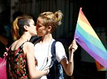 LGBT rights activists kiss during a transgender pride parade which was banned by the governorship, in central Istanbul, Turkey, June 19, 2016. REUTERS/Osman Orsal