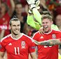 Wales's Gareth Bale, center, smiles while celebrating with team mates after the Euro 2016 Group B soccer match between Russia and Wales at the Stadium municipal in Toulouse, France, Monday, June 20, 2016. (AP Photo/Thanassis Stavrakis)