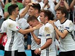 Germany's forward Mario Gomez (C) celebrates scoring the opening goal with team mates during the Euro 2016 group C football match between Northern Ireland and Germany at the Parc des Princes stadium in Paris on June 21, 2016. / AFP PHOTO / KENZO TRIBOUILLARDKENZO TRIBOUILLARD/AFP/Getty Images