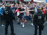 Riot police monitor England fans outside the train station in Lille city centre, France, as fresh clashes have taken place between England fans and Russian hooligans at Euro 2016. PRESS ASSOCIATION Photo. Picture date: Wednesday June 15, 2016. Video posted online showed Russian hooligans approaching a group of English and Welsh fans as they drank together. See PA story SPORT Euro2016. Photo credit should read: Niall Carson/PA Wire